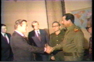 Donald Rumsfeld shaking the hand of Saddam Hussein in 1983