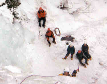 CMC HAMS ice climbing class above Vail with Scott Nykerk coming over the top by Roger Wendell - 02-05-2000