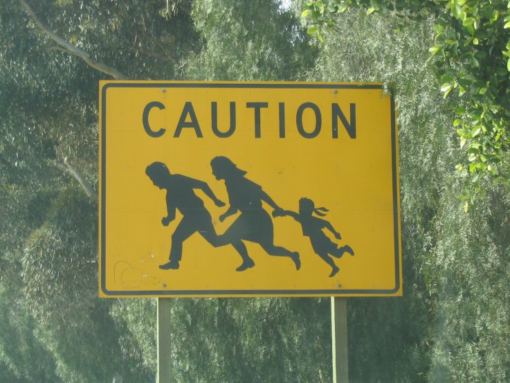Immigrant Crossing Sign in San Diego by Roger J. Wendell - 03-18-2004