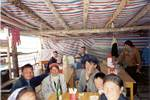 Uyghur Lunch Crowd in the Country - Xinjian Province, China - 2001